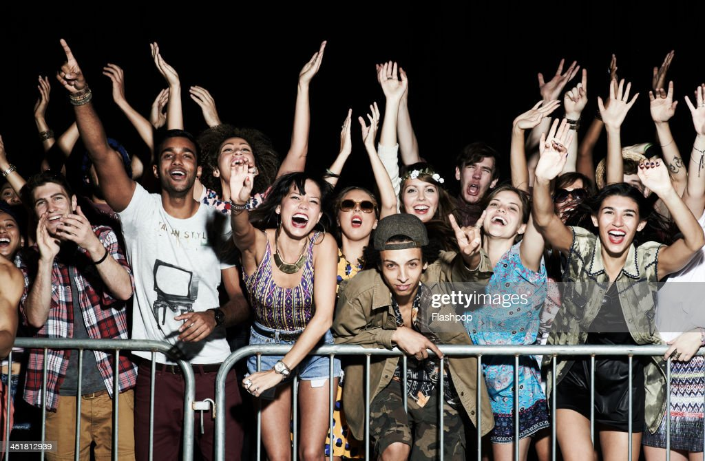 Group of people having fun at music concert : Stock Photo