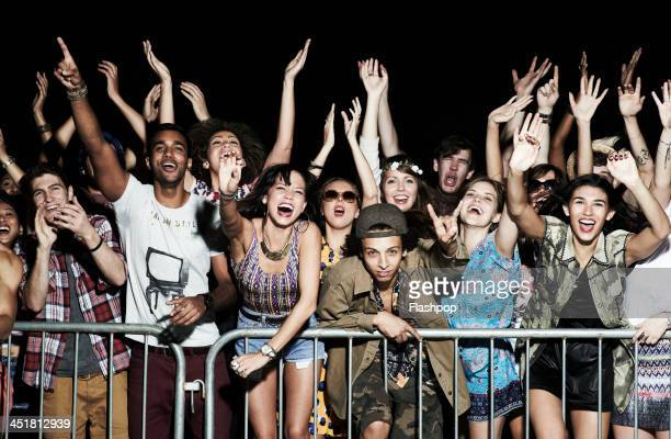 group of people having fun at music concert - supporter stock pictures, royalty-free photos & images