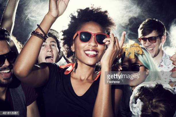 group of people having fun at music concert - human arm stock pictures, royalty-free photos & images