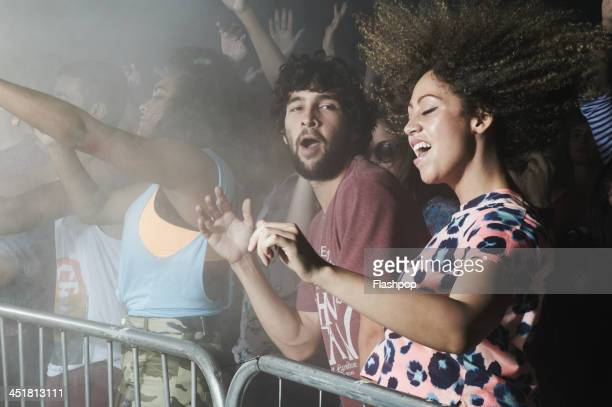 group of people having fun at music concert - popular music concert stock pictures, royalty-free photos & images