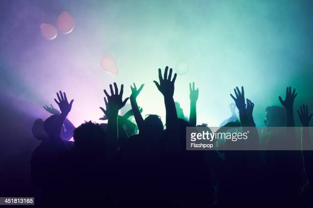 group of people having fun at music concert - hand raised stock pictures, royalty-free photos & images