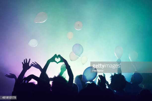 group of people having fun at music concert - music festival stock pictures, royalty-free photos & images
