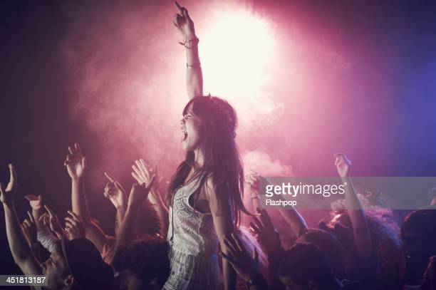 group of people having fun at music concert - excitement stock pictures, royalty-free photos & images