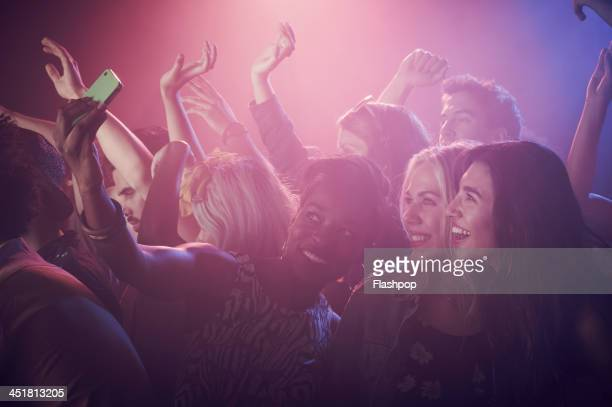 group of people having fun at music concert - ポップコンサート ストックフォトと画像