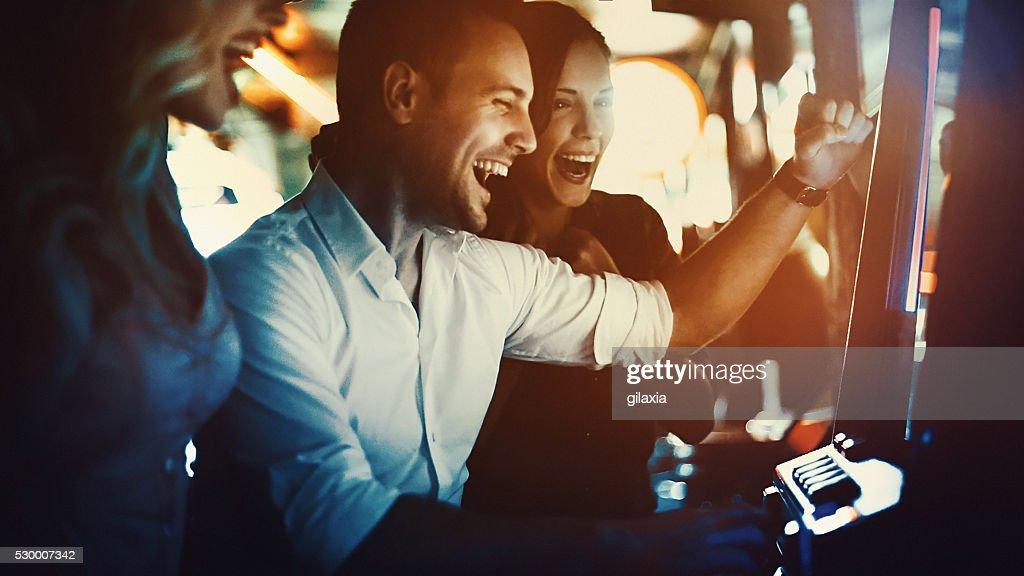 Group of people having fun in casino. : Stock Photo