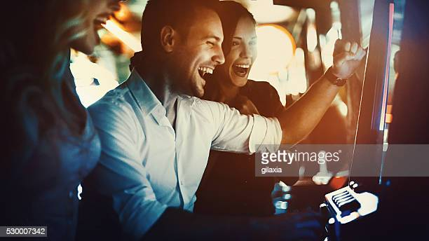 group of people having fun in casino. - gambling stock pictures, royalty-free photos & images