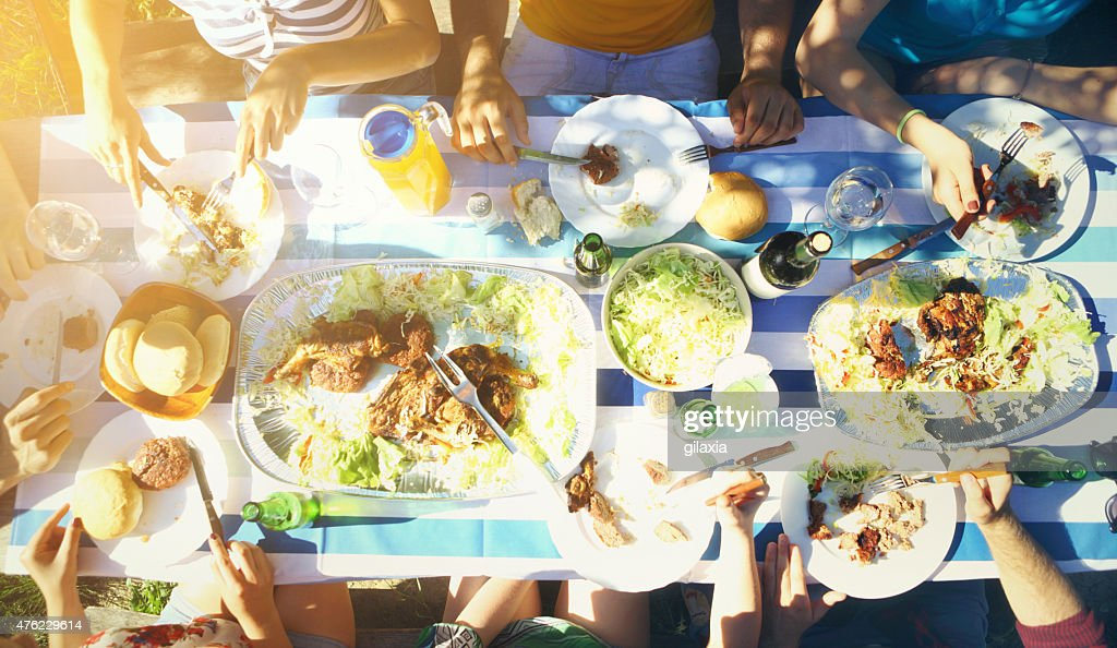 Group of people having lunch outdoors. : Stock Photo