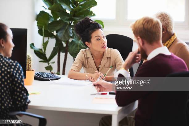 group of people having meeting in office - place of work stock pictures, royalty-free photos & images