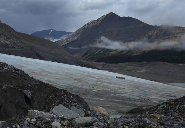 Group Of People Hiking On A Glacier, Golden, Canada