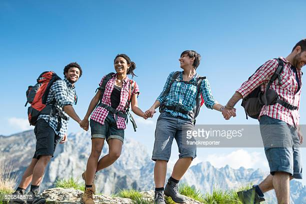group of people hiking the mountain togetherness
