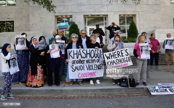 A group of people hold pictures of missing Saudi journalist Jamal Khashoggi during a demonstration in front of the Embassy of Saudi Arabia in...