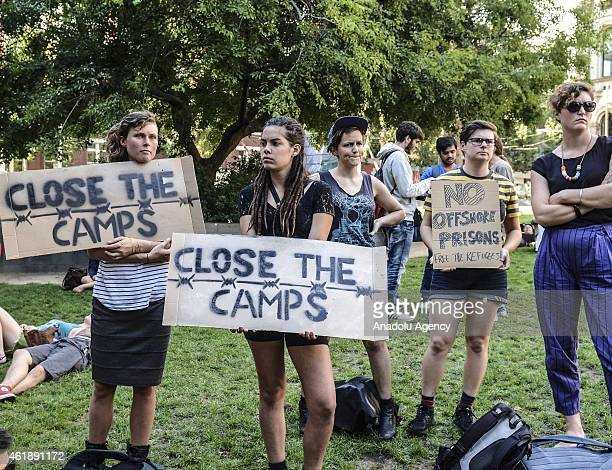 A group of people hold placards during a protest in Melbourne Australia on January 22 2015 to support the Manus Island asylum seekers and call for an...