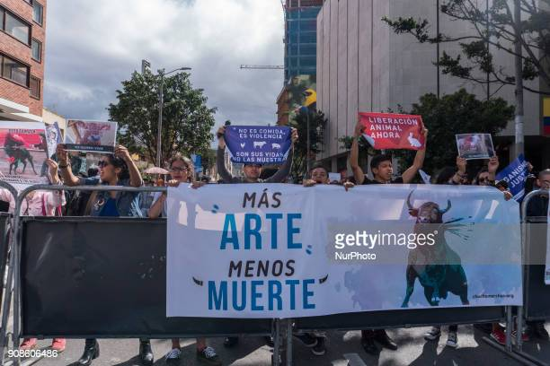 A group of people hold posters against the bullfight in the Plaza de Bolívar Bogotá Colombia on 21 January 2018