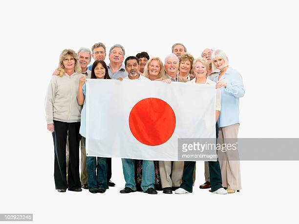Group of people holding a Japanese flag