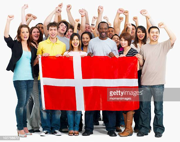 Group of people holding flag