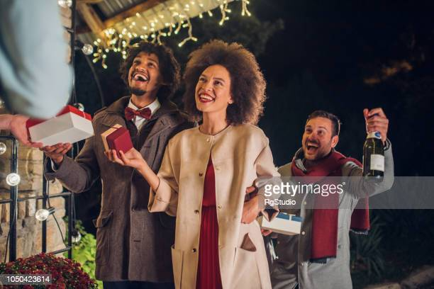 group of people holding gifts - hello december stock pictures, royalty-free photos & images