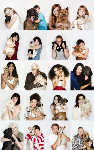 Group of people hugging their pets - gettyimageskorea