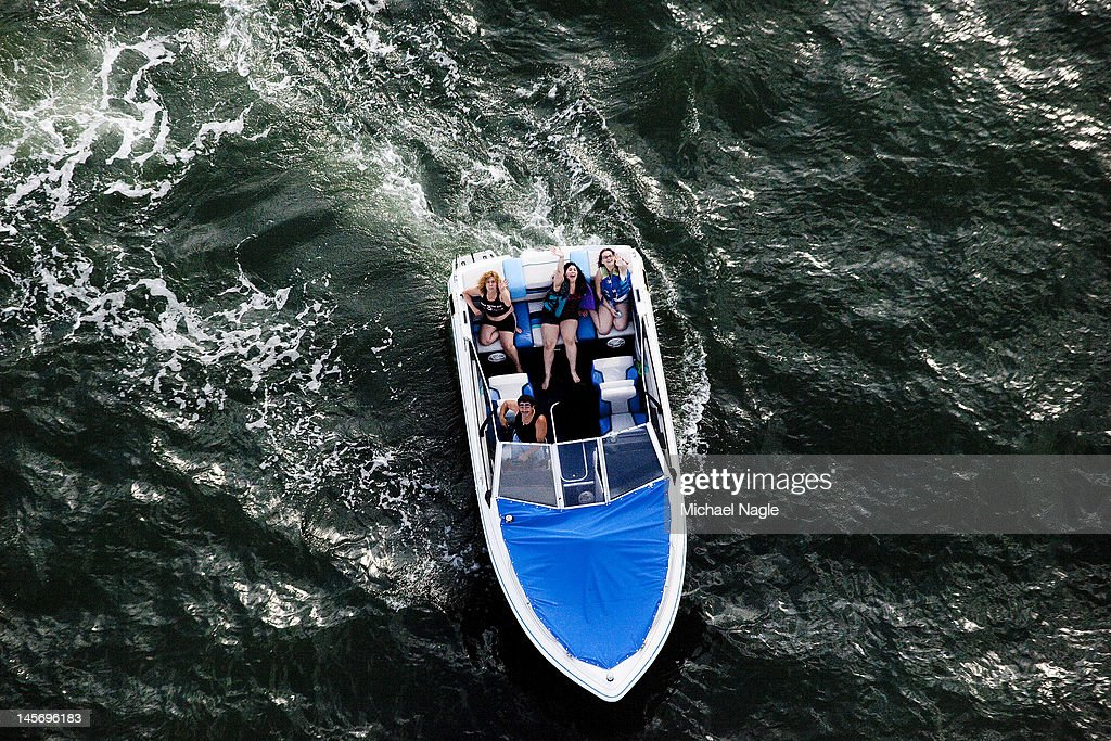 A group of people in a boat follow Space Shuttle Enterprise as it passes Coney Island on June 03, 2012 in New York City. Enterprise is on it's way to the Intrepid Sea, Air and Space Museum, where it will put on permanent display.