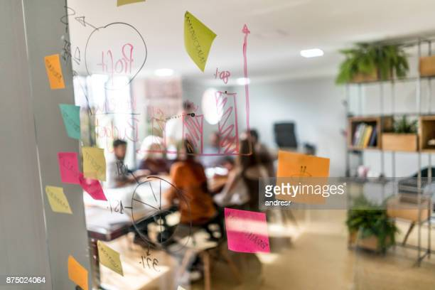 group of people in a business meeting at a creative office - strategia foto e immagini stock