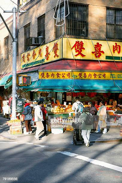 group of people in a fruit market, chinatown, manhattan, new york city, new york state, usa - chinatown stock pictures, royalty-free photos & images