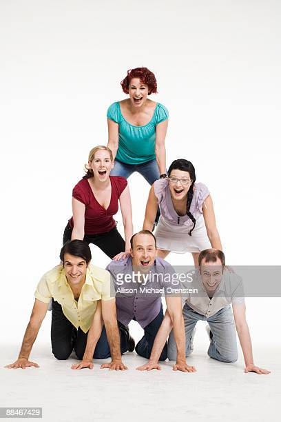 A group of people in a human pyramid