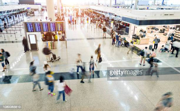 group of people in airport - airport stock pictures, royalty-free photos & images