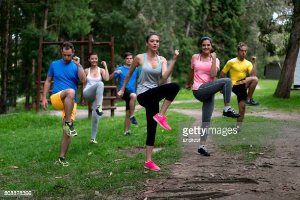Group of people in an aerobics class at the park