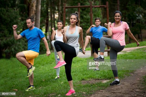 Group of people in an aerobics class outdoors