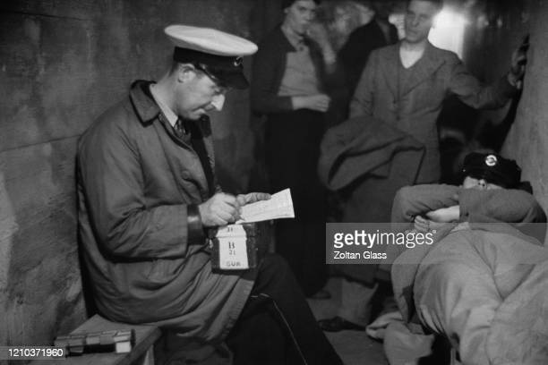 A group of people in an air raid shelter during the Blitz London October 1940 Original Publication Picture Post 308 Shelter Life pub 26th October 1940