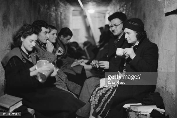 Group of people in an air raid shelter during the Blitz, London, October 1940. Original Publication: Picture Post - 308 - Shelter Life - pub 26th...