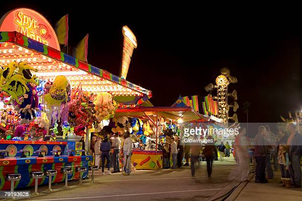 group of people in an amusement park, riverfront park, cocoa beach, florida, usa - cocoa beach stock pictures, royalty-free photos & images