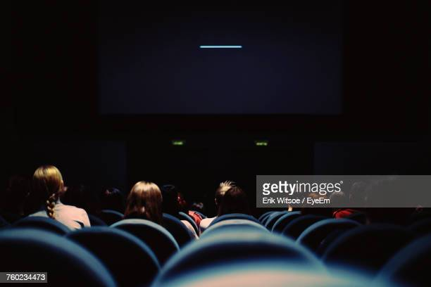 group of people in auditorium - projection screen stock pictures, royalty-free photos & images