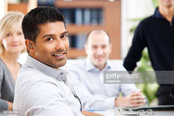 a group of people in business casual dress - assistive technology stock photos and pictures