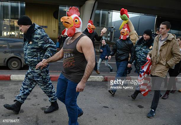 A group of people in chicken and cock costumes protest Pussy Riot members Nadezhda Tolokonnikova and Maria Alyokhina at Vnukovo International Airport...