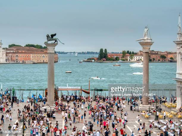 group of people in front of sea in venice - venice italy stock pictures, royalty-free photos & images