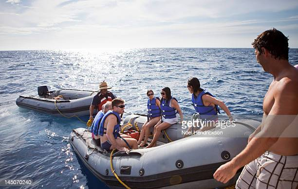 A group of people in inflatable boats