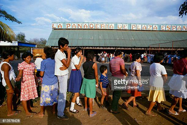 A group of people in Managua Nicaragua wait in line to buy cheap bread Rising to power within the Nicaraguan government in the 1980s the leftwing...