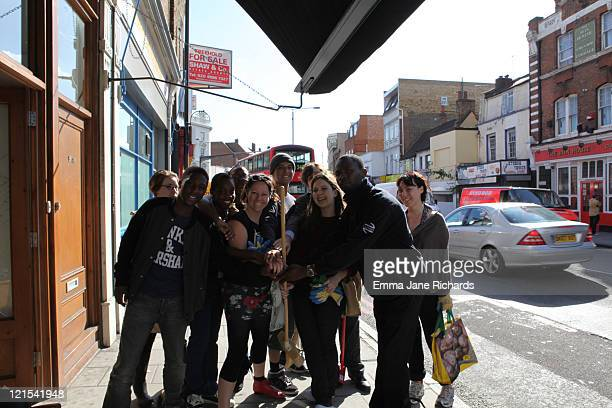 Group of people in Peckham helping to clean up after the riots