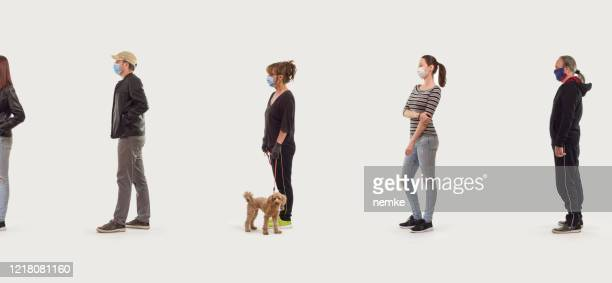 group of people in queue, social distancing concept - distant stock pictures, royalty-free photos & images