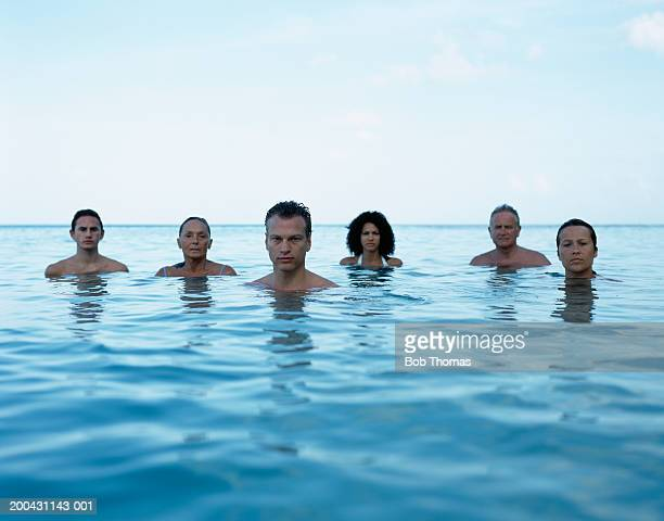 group of people in sea, portrait - sea swimming stock pictures, royalty-free photos & images