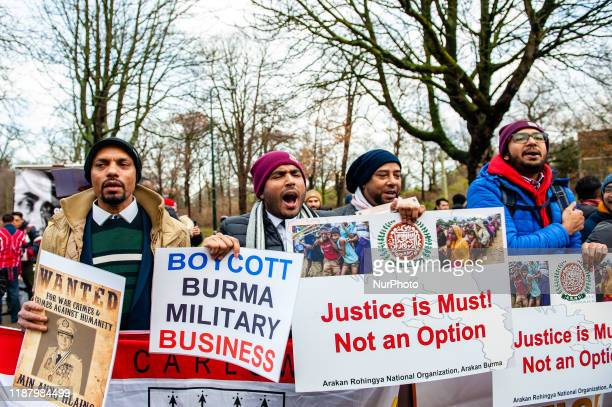 Group of people in support of Rohingya are shouting slogans and holding placards, during a Rohingya solidarity rally in front of the ICJ, The Hague,...