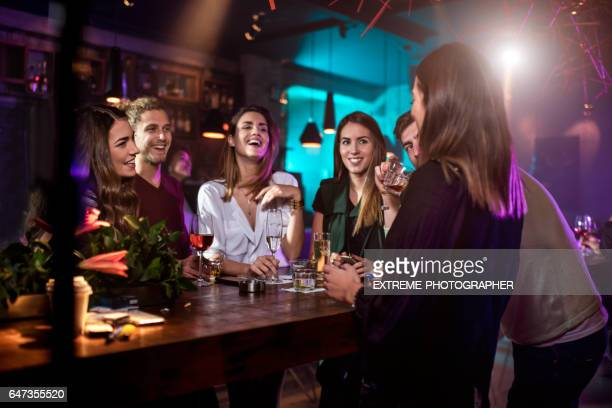 group of people in the bar - party social event stock photos and pictures