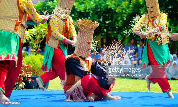 group of people in traditional clothing during festival - traditional ceremony stock pictures, royalty-free photos & images