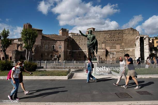 Group of people in Via Dei Fori in Roma after the lockdown of the nation due to the Covid-19 outbreak, Roma, 14th June, Italy. All the museums...