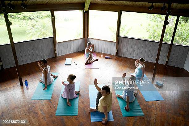 Group of people in yoga class, elevated view