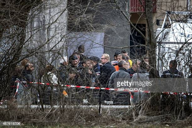 A group of people including relatives of the Germanwings Airbus A320 crash victims arrive in SeynelesAlpes on March 26 two days after the Germanwings...