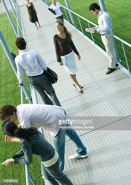group of people involved in different activities on walkway - 斜めから見た図 ストックフォトと画像