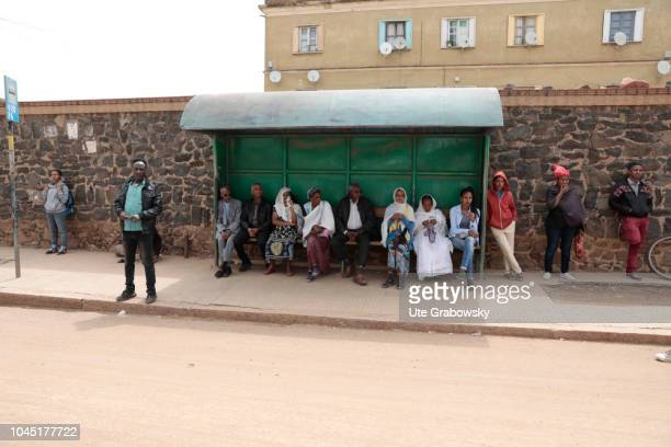 A group of people is waiting at a bus stop on August 24 2018 in Asmara Eritrea