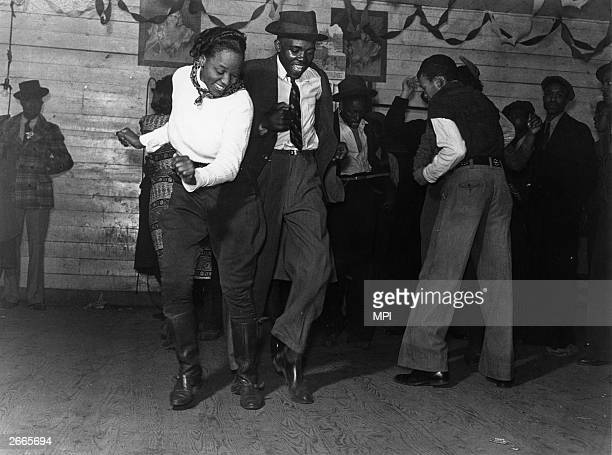 A group of people jitterbugging in a juke joint in Clarksdale Mississippi