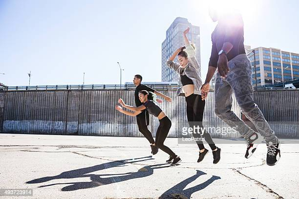 Group of people jumping in DUMBO - New York